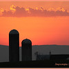* July 21, 2011. Barn and silos at sunset, Mason Dixon line. MD and PA